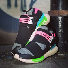 Jam packed with eclectic sports elements, the @y-3 Qasa High trainers feature neon detailing and elastic webbing which is crossed over the sock-like upper