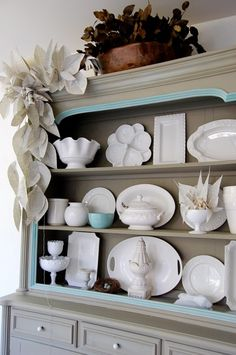 20 Ways to Decorate With Book Pages {and other things about the book party} Love the cabinet for the kitchen and pottery. Decorating Above Kitchen Cabinets, Kitchen Cupboards, Book Page Garland, Book Page Crafts, White Dishes, White Plates, Old Book Pages, Painted Furniture, Painted Hutch