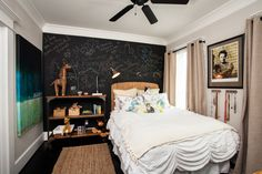 Daughter Haley, now a college student, has a fun bedroom to return to when visiting. A chalkboard wall signed by family and friends is a tre...