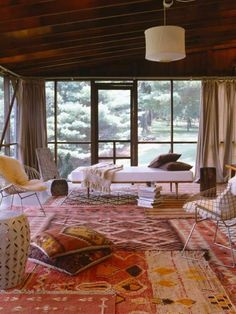 Layered rugs... cool as living room or relax room