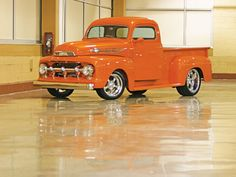 1952 Ford F-1in Orange. Put wood sides on that mother and call me home.