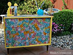 Decoupaged Game Cabinet via ( Bleak-2-Unique ) What an Outstanding idea for a family room!!