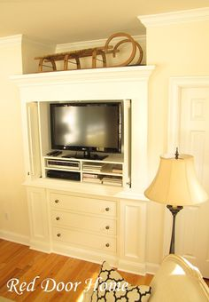 Up until about five years ago, this space was occupied with an antique wardrobe which we used to house the television. We were lucky to have a very talented local carpenter create this beautiful custom cabinet and are thrilled he most likely will be coming back to build the bookcases as well.