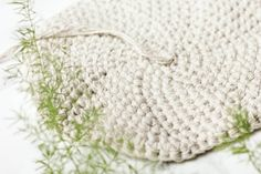 Inexpensive utilitarian twine (from Dollar Tree!) and a thrifted leather belt combine to create a primitive, yet sophisticated home decor piece. This free crochet basket pattern is exceptionally easy to make with only single crochet stitches and can be customized to any size. Click for the free pattern and photo tutorial.