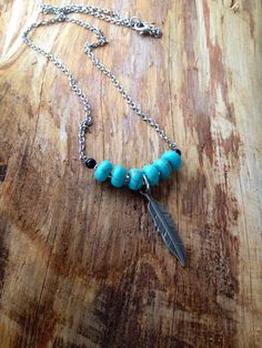 Turquoise Feather Necklace on Etsy, $18.00