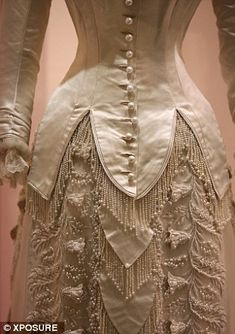 Intricate: The back of these dresses reveal the delicate stitching and elaborate embellishment that goes into many wedding dresses