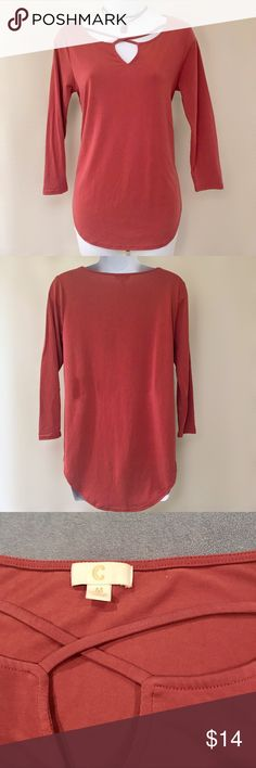 Soft and Sexy Hi-Lo Tunic Top Sweet and sexy rose color tunic top has strappy front and trendy hi-lo jersey hem Three quarter sleeves Material is super soft and stretchy Excellent condition - no signs of wear Bust is 18 inches flat, length is 25 inches in front, 27 inches in back Charming Charlie Tops Tunics