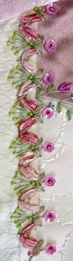 "I ❤embroidery . . . Not a TAST, but I just love this seam. It may be one of my favorites. I began with a cretan base and laced that with the ""party ribbon yarn. then added detached chain, straight stitches, flower sequins and beads. ~By Suzie W"