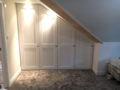 Making the most of all of the space - this wardrobe built into the angled ceiling gives so much storage with not an inch of wasted space!