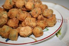 Southern Deep Fried Okra | Sliced okra is dipped in buttermilk and then dredged in a lightly seasoned mixture of cornmeal and flour, then deep fried to crispy perfection.
