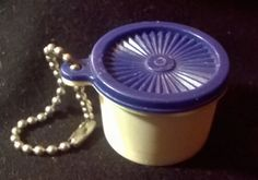 Servalier Canister Keychain by Tupperware made in Hong Kong. This item was available years ago and is Rare and Highly Collectible. This keychain is in