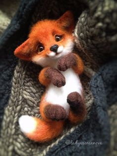 Precious fox made of felt.