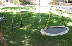 an old ski rope, a trampoline turned into swing and a rope- all hanging from a tree makes a great obstacle course- and also provides great sensory input