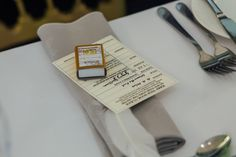 Winnie the Pooh library card place setting & matchbox book favour (Photo by Helena Dolby Photography)