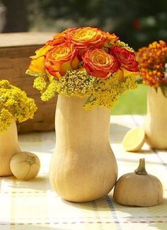 What do squash and flowers have in common? Not much, but it's a creative way to display flowers for #Thanksgiving or events this fall. Hollow out the inside, make a squash soup, and use the rest as the vase! #recycle