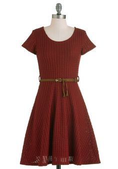 """""""Beautiful Bibliophile Dress"""" from ModCloth.com. Item description: """"You may always have your nose stuck in the black-and-ecru lines of a classic novel, but your style is in full color and scholastically fabulous, as evidenced by the maroon hue of this cable-knit dress. Navigating to class with your peripherals leading the way and your mind in another era, you're noticed by other bookworms due to the elegant skirt-sway of this fit-and-flare piece..."""""""