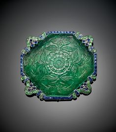 CARTIER,Brooch with Carved Emeralds and Saphires by Cartier Maker: Cartier (French, founded Paris, 1847) Object Name: Brooch Date: ca. 1920 Geography: United States, New York Medium: Platinum, set with emeralds and sapphires MET