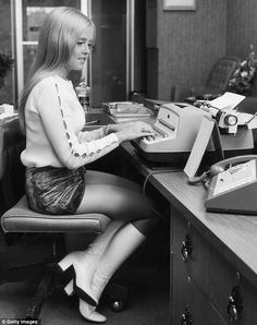 The  secretary dress code by 1970! One of my secretaries wore something like this ALL the time in 1970 and 71 and bought a NEW Gremlin  to drive around in too! Poor gal here - the boss didn't even buy her an IBM Selectric typewriter - she's got the old cheaper model!