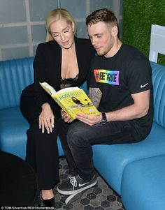 Page turner? Also skimming Lapin's 12-step career guide for the cameras was openly gay Olympic Silver Medalist skier Gus Kenworthy