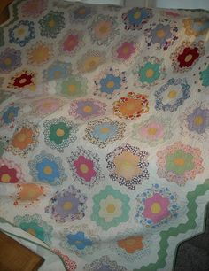 "Love old quilts. I have one similar to this. My great grandma made it. I think she called it "" grandmas flower garden"". Miss my great grandma and cherish this quilt."