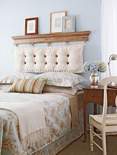 Cute headboard idea. Sew buttons into a bench cushion and ribbons to the top. Hang from hooks attached to crown molding. This way you won't even need a pillow behind your head while reading in bed!
