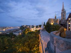 Fishermen's Bastion at Castle Hill, View along Fishermen's Bastion to Matthias Church at Castle Hill at night, Buda, Budapest, Hungary