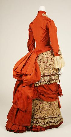 Wonderful silk day dress, ca.1880. Made in American with cotton Irish crochet embellished with beads. Click on the photo to see some close ups of how the maker accented the crocheted elements.  In the collection of the Metropolitan Museum of Art at