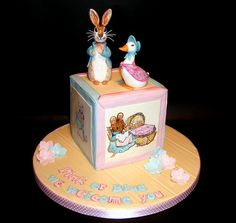 Oh how I loved making this Beatrix Potter themed baby shower cake. It's the first baby shower cake I have made. The plaques on each side of the baby block are hand painted. Baby Shower Cupcakes, Shower Cakes, Baby Shower Themes, Shower Ideas, Beatrix Potter Cake, Christening Cake Girls, Peter Rabbit Cake, Sculpted Cakes, Character Cakes