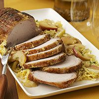 A lean pork tenderloin is cooked with apples, onion, and coleslaw mix in this slow cooker dinner recipe.