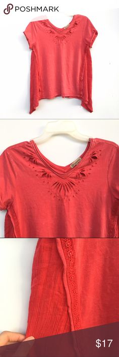 Laser Cut Out Asymmetric Top Short sleeve asymmetric top with a different fabric on the asymmetric parts. Laser like cut outs by the neckline in flower like designs, similar to a Free People shirt. Democracy Tops Tees - Long Sleeve