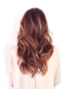 Long healthy hair with soft golden ombre or sombre. Sexy waves too!