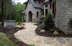 Front yard landscape with stones and gravel.