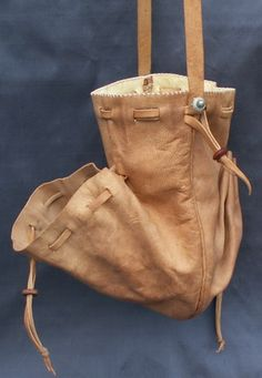 These purses are made from vegetable tanned goat skins that have been dyed using period dyes. They are lined with chamois and are made entirely by hand. The design is based on a figure in 'The Wedding Dance In The Open Air' by Pieter Bruegel painted in 1556. It hangs from a leather cord and is 8 x 6 inches (20 x 15 cms) when open. The main section is wide enough to get your hand inside and the two outer pockets are held closed with their own drawstrings.  £50