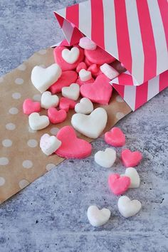 Pink and white Valentine candy hearts in small and big sizes spilling out of a pink and white striped bag onto brown polka dot paper. Valentine Candy Hearts, Valentines Day Desserts, Candy Recipes, Wine Recipes, Holiday Recipes, Colored Sugar, Romantic Meals, Polka Dot Paper, Homemade Candies