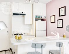 Loving the pink wall...nice way to personalize a tiny apartment kitchen!  Small kitchen - Style At Home