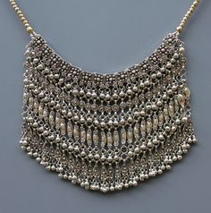 A finely made silver labbeh necklace from Yemen or Saudi Arabia.  It is made of a lower silver content alloy which is below .600 silver content, probably .400-.500. I feel it shows the beauty that is achieved in humbler materials. The labbeh was worn in at least four ways by Muslims and Jews in Yemen and Saudi Arabia: as a necklace, on top of the head, as a chin-chain attached to a headdress, and as a veil.  Early 20th century.