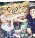 Maya and Josh at the pooh ride in Disneyland