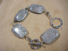 Gray Marblized Jasper with Hand Forged and Hammered Sterling Silver Ring. $44.00, via Etsy.