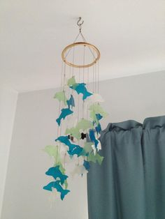 My new wind chime.  Dolphins made from shells.  The colors look so nice in my bedroom!
