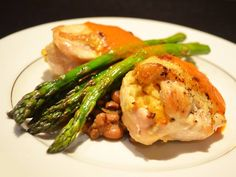 Chicken 'Cordon Blues'...skin-on breast of chicken stuffed with smoky bacon and Sweet Grass Dairy cheese with pimento butter sauce, served with braised field peas and grilled asparagus spears. www.affairs.com