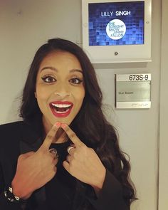 Pin for Later: 10 Reasons Lilly Singh Is the Ultimate Beauty Superwoman She was born to wear red lipstick. Check out that bold cat eye, too!