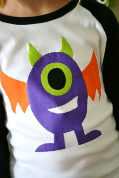 Adorable kids diy monster shirt! Halloween Monster Bash Full of Awesome Ideas via Kara's Party Ideas | KarasPartyIdeas.com #Halloween #Party #Ideas #Supplies #monster #shirt #diy