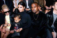 North West on mom Kim Kardashian's lap at Balenciaga's S/S 15 show today in Paris. // #Celebrity #KanyeWest