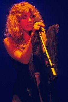 Black dress and big hair, Stevie Nicks style.