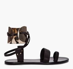 Lanvin cuff sandals by Alber Elbaz. Look even better on but I can't find the shot where I first spied them (InStyle).