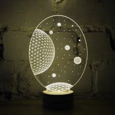 These optical illusion LED lights use cutting edge — and eco-friendly — technology and simple materials to utterly magical effect. This Bulbing Galaxy Lamp's special etched acrylic plate guides light through its contours, creating a glowing, 3D cosmos out of (seemingly) thin air. Diffuse and dynamic, with a simple birch base, it will enhance your space and blow your mind.