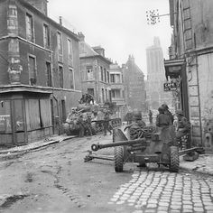 British Sherman tanks and a anti-tank gun in the centre of Caen, Normandy, 10 July One of hundreds of images from the Normandy campaign to be found in the 'Overlord' app for the iPad. Normandy Ww2, Normandy Invasion, Normandy Beach, Normandy France, Ww2 Pictures, Ww2 Photos, Canadian Army, British Army, Canadian Soldiers