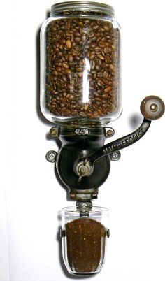 This is awesome! Totally want this vintage looking wall mounted coffee grinder!