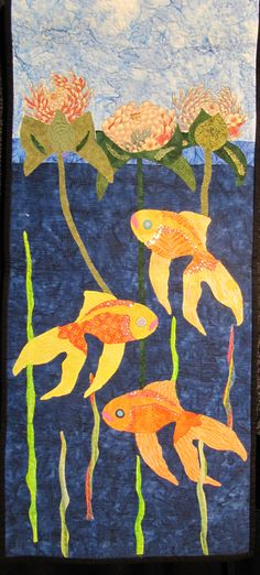 I love these fish swimming in the lily pond,
