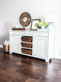 Take the centre doors off a cabinet, paint it, add baskets.